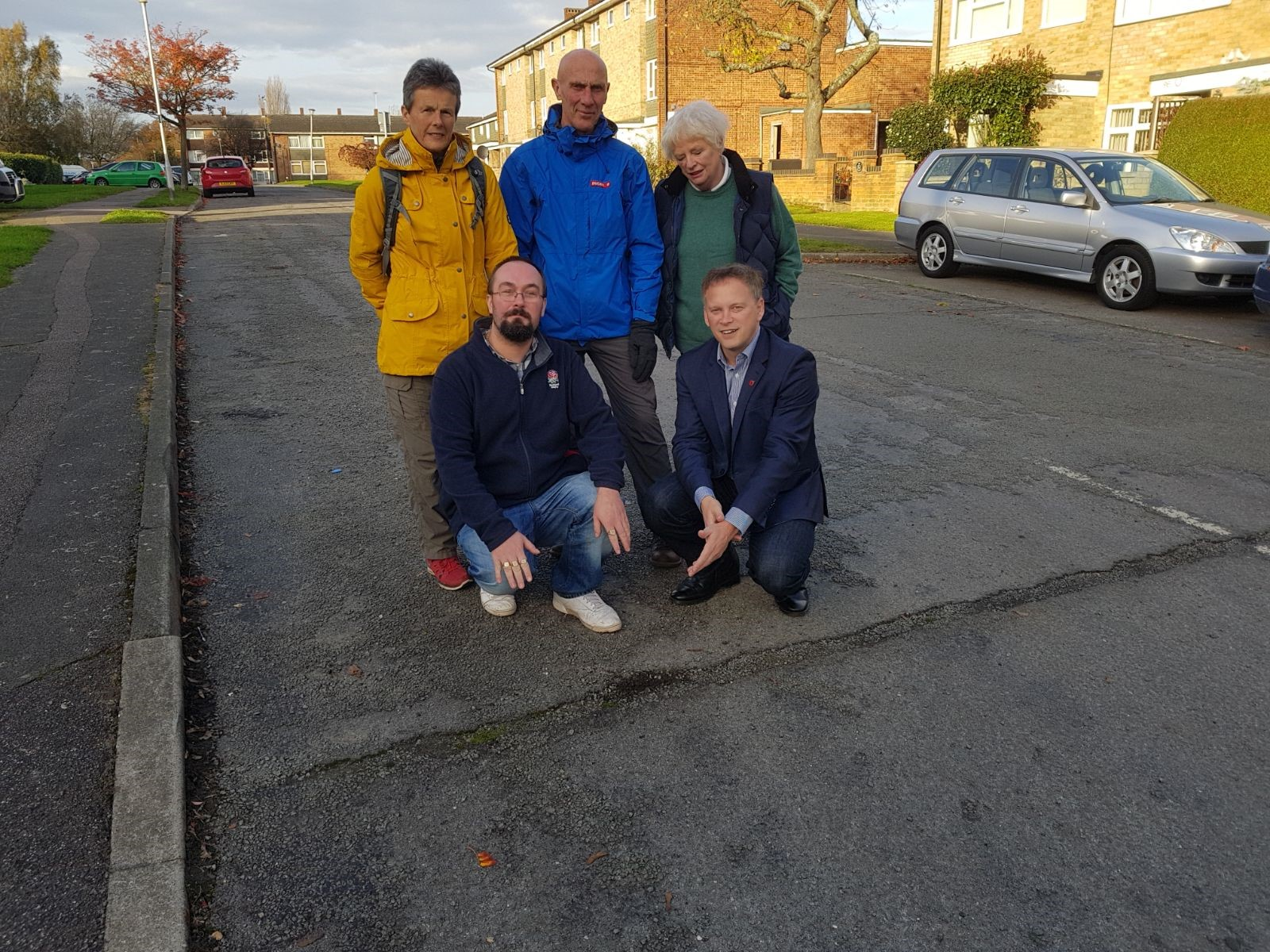 Shapps inspects poor road surface in Hillfield with local residents